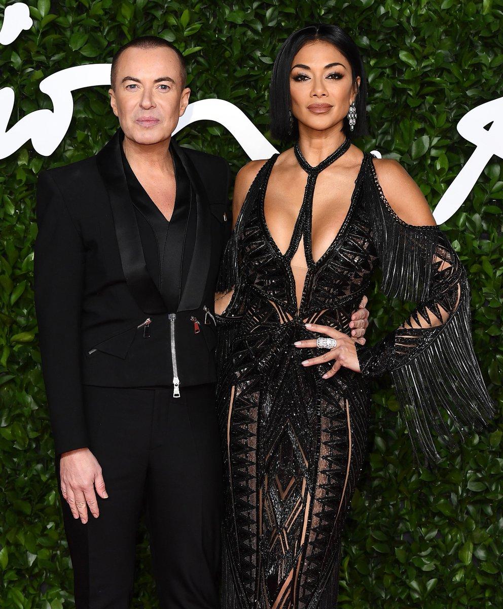 @LondonFashionWk designer @JulienMacdonald and @NicoleScherzy arriving at The #FashionAwards 2019!