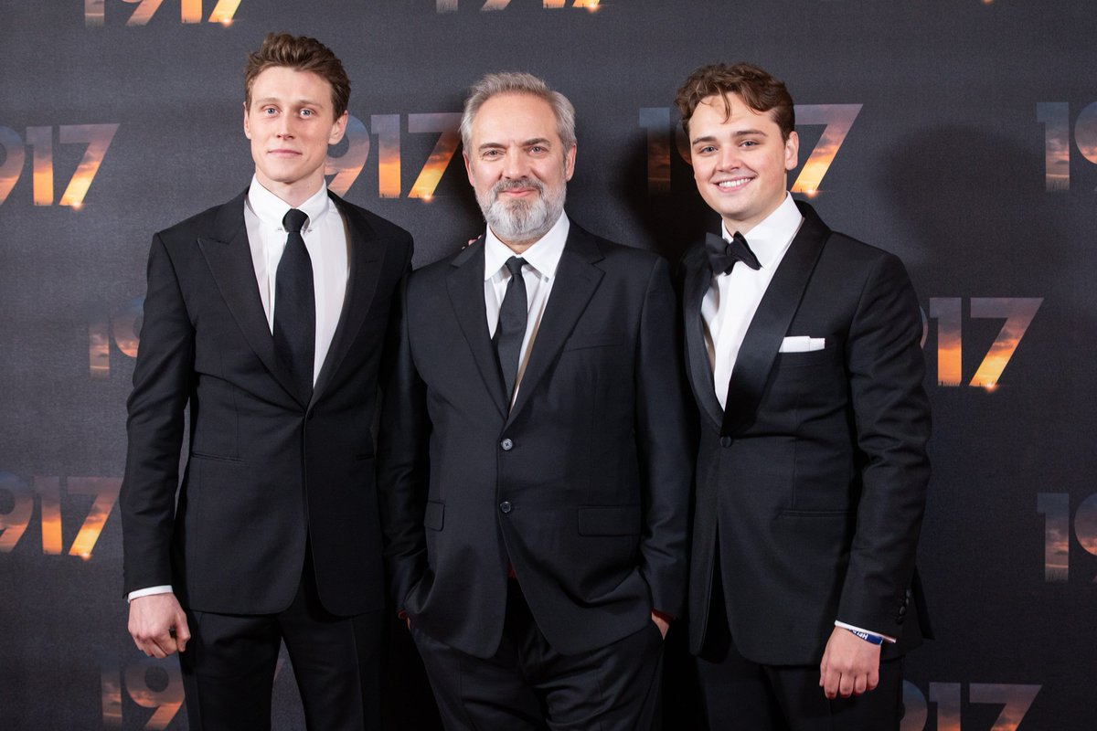 Our leads George MacKay and @Dean_C_Chapman stand together with director Sam Mendes at the World Premiere of #1917Film.