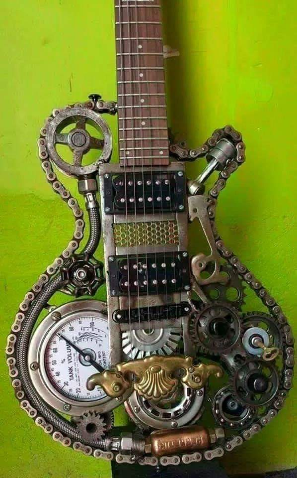 #Steampunk ⚙️ Awesome of the Day: Customized #Guitar 🎸 With #Bike Chain Gauge Tube Gears and Cogs via @Steampunk_T #SamaGuitars #SamaMusic 🎶