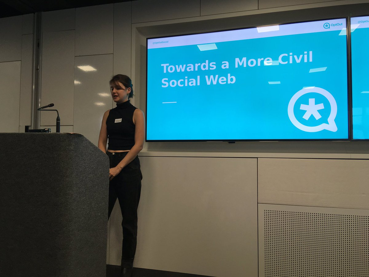 Teresa speaking at the podium at IndieWebCamp at Mozilla Berlin with a display behind her showing a slide titled Toward a More Civil Social Web.