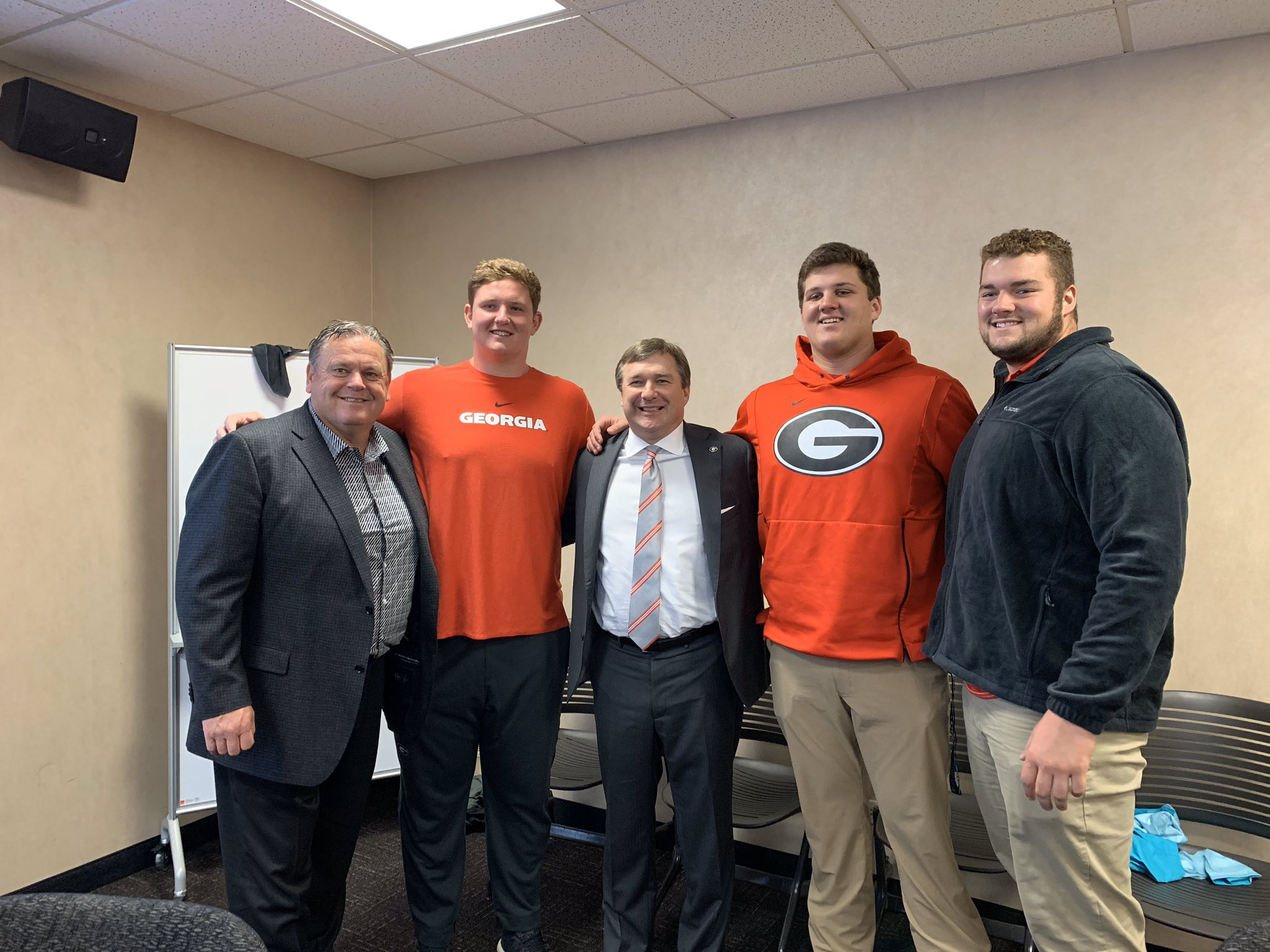 Photo: Sam Pittman (left), Kirby Smart (center), with 2020 offensive line commits Joshua Braun, Chad Lindberg, and Tate Ratledge.