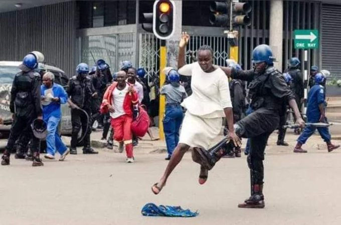 Zim riot cop trips up a running woman