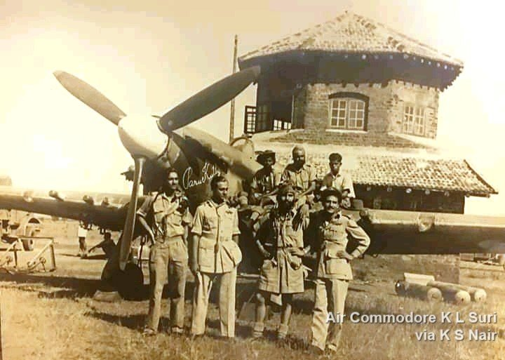 """#iafpics365 [330/365] At this time 75 years ago 2 Sqn @IAF_MCC had just completed its move from Kalyan via Cox's Bazaar to Mambur.  This pic shows a 2 Sqn Hurricane against an unusual-looking building, with word-art on its nose reading """"ParuKutty"""" ... pic.twitter.com/pOwpsqLBwa"""