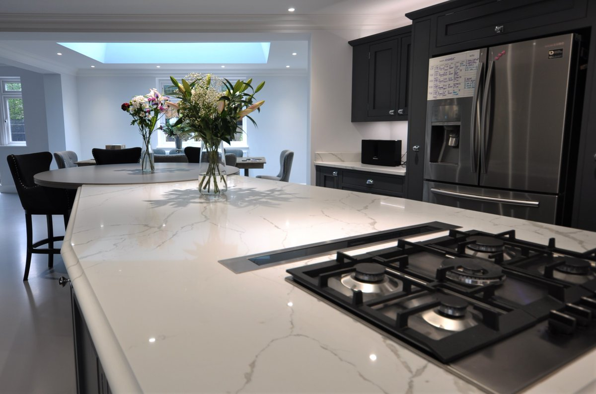 Calacatta Quartz Worktops fitted for a private customer in Loughton, Essex. Finished off With a Circular Caesarstone 40mm Raw Concrete Table. #CalacattaQuartz #Quartzworktops #QuartzworktopsEssex #caesarstoneuk