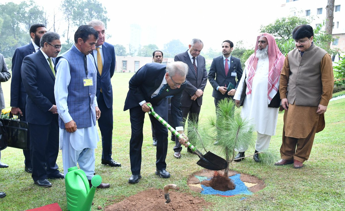 President Dr. Arif Alvi planting a sapling during the Envoys Conference on Africa at Foreign Office, Islamabad.