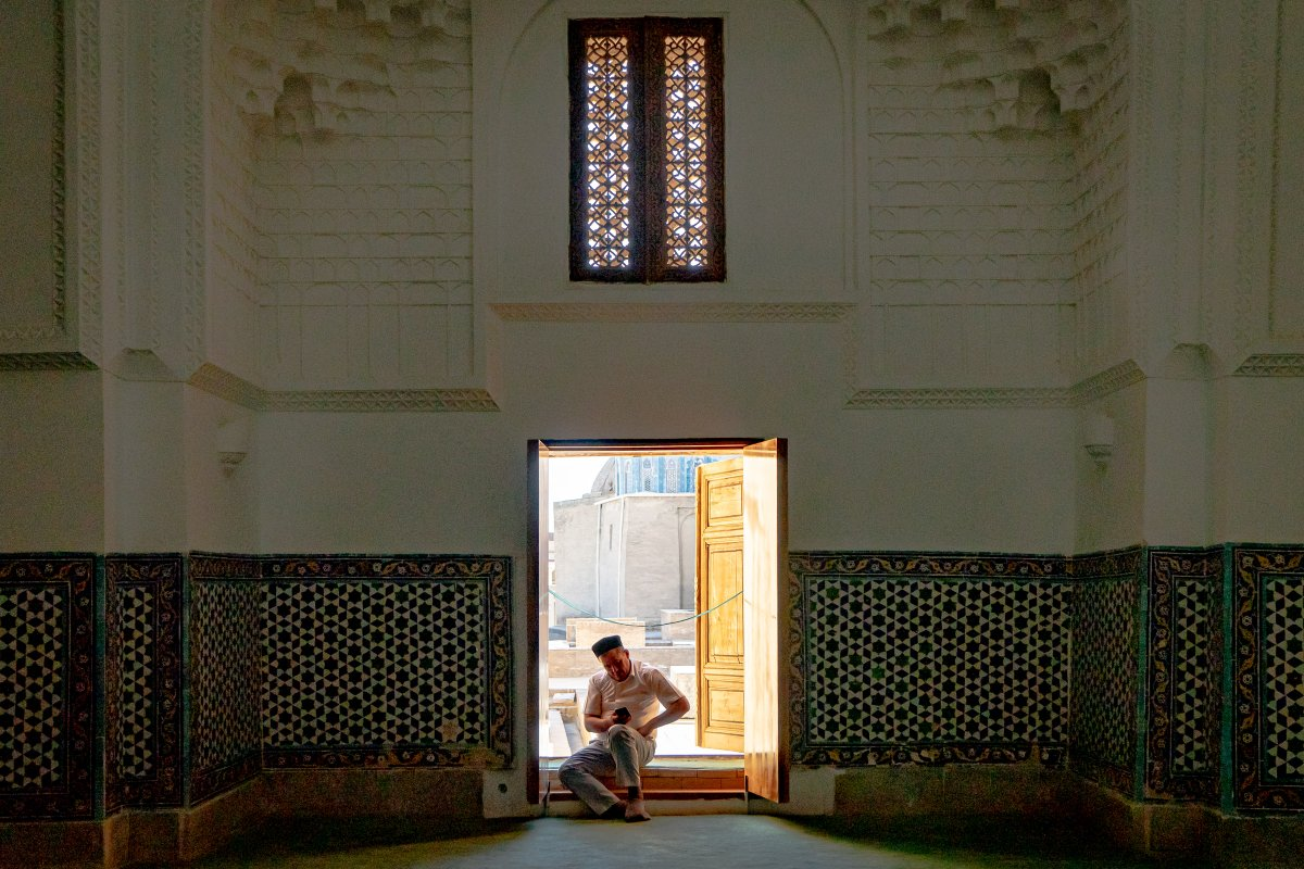 A quiet moment (and a quick check of the phone) in a mosque at Samarkand in Uzbekistan.#TravelCentralAsia #TravelUzb