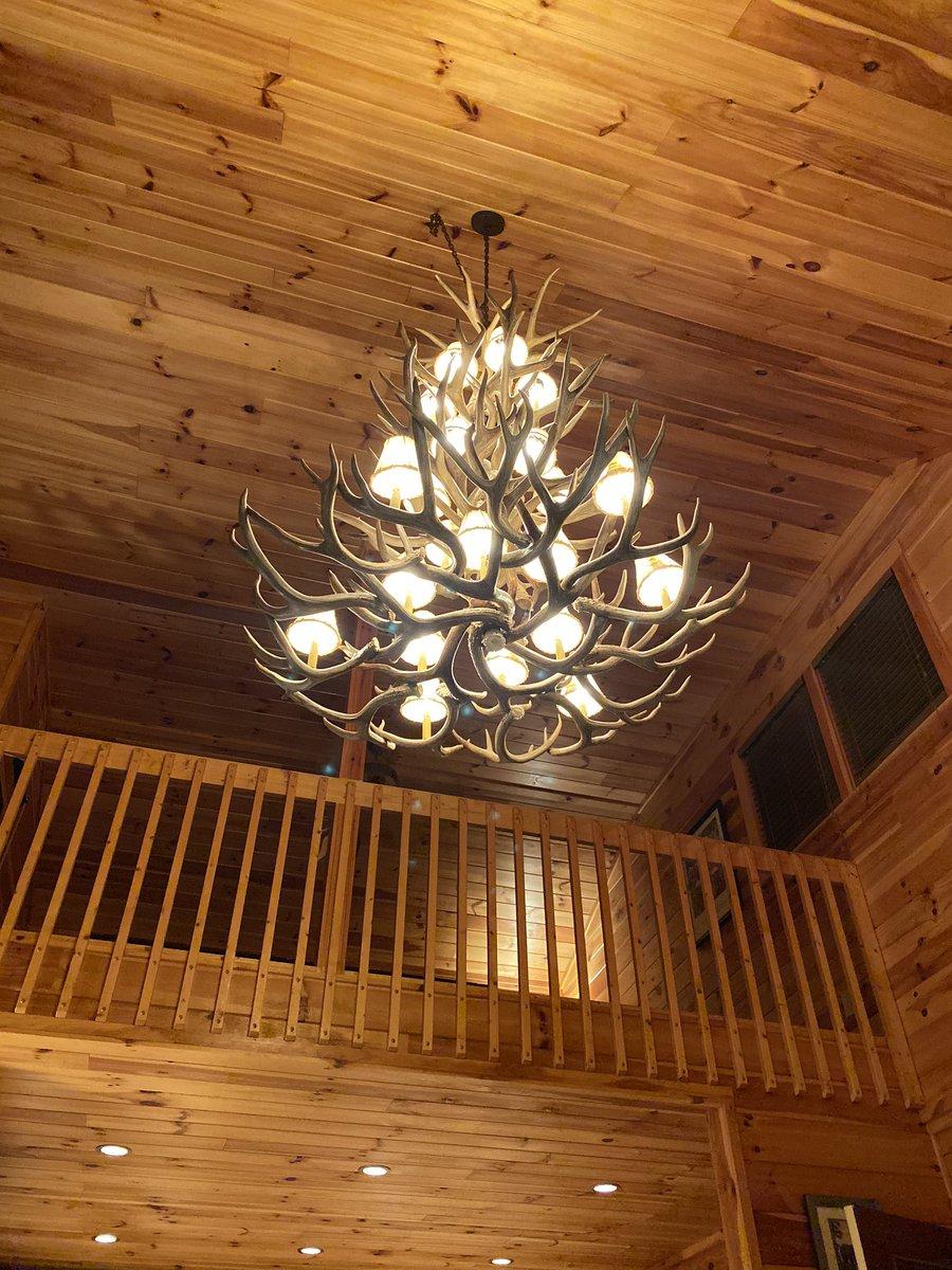 the chandelier is made of deer antlers