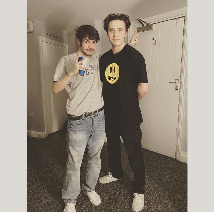 Checkout this photo of Rex Orange County with Brooklyn Beckham, sporting Drew House!