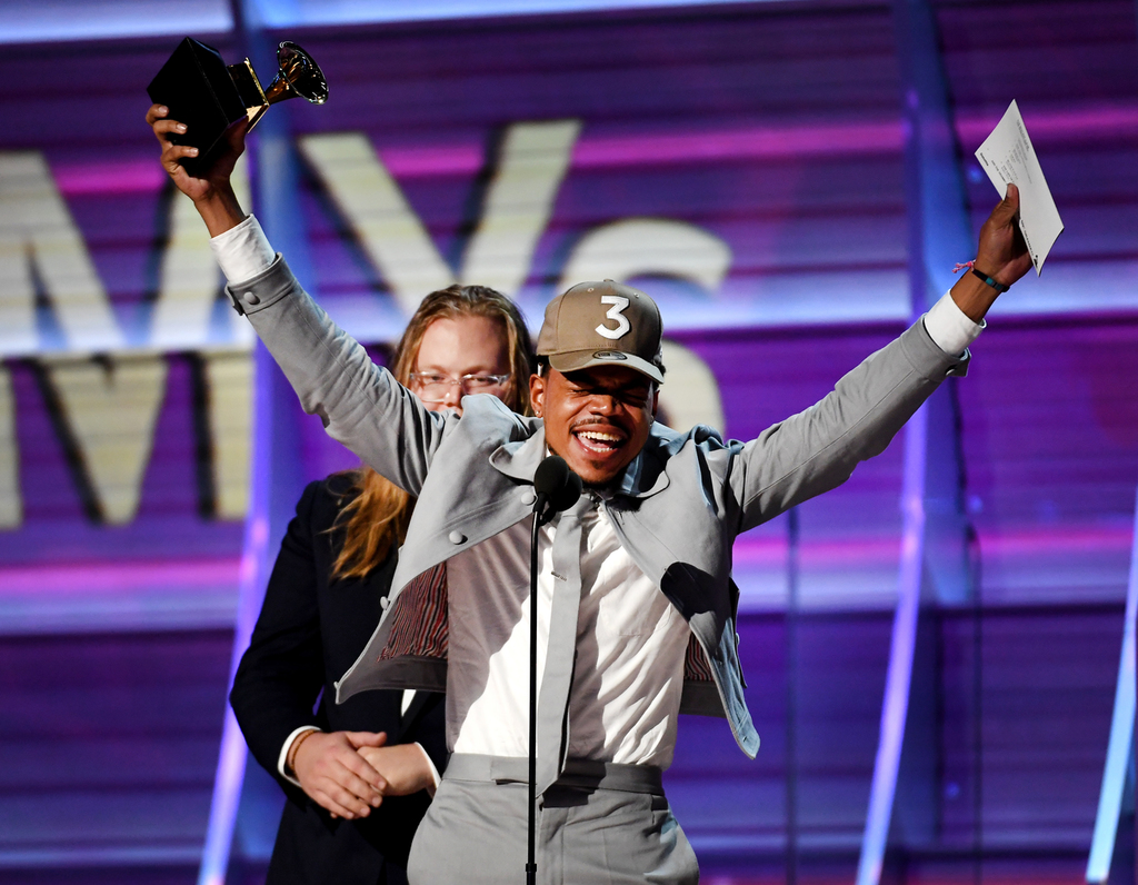 Breaking records is no problem for @chancetherapper. The 3-time GRAMMY-winner is the first streaming-only artist to win a GRAMMY. He's also the first male rap solo artist to win Best New Artist. 👏 #GRAMMYVault