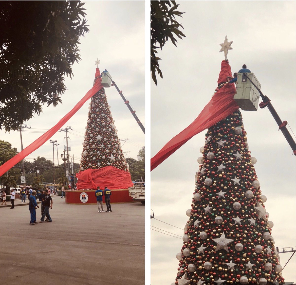 Manila LGU and Engineering Department wraps the Christmas tree display near the Bonifacio shrine with a big red cloth in preparation for Typhoon #TisoyPH | via @ZyannAmbrosio