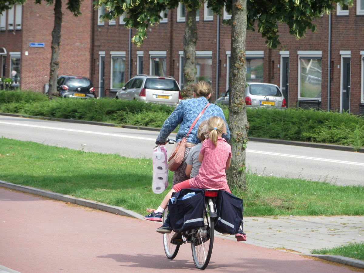 Shopping with children on bikes in the Netherlands