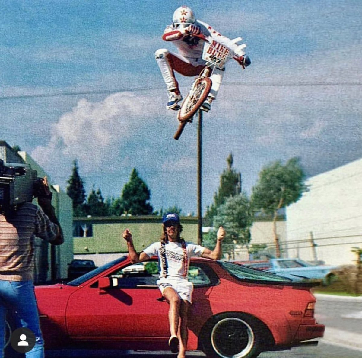 If this picture doesn't go down in history as one of THEE raddest BMX photos of all time, we don't know what does! That's @mikebuff_ jumping over a #porsche & the Duke of Oakley, Dana Duke! TO FLAT! #80sbmx radness! #oldschoolbmx #bmxfreestyle #bmxlegend #bmx #bmxstreet #seracingpic.twitter.com/YzrdtSRsoa