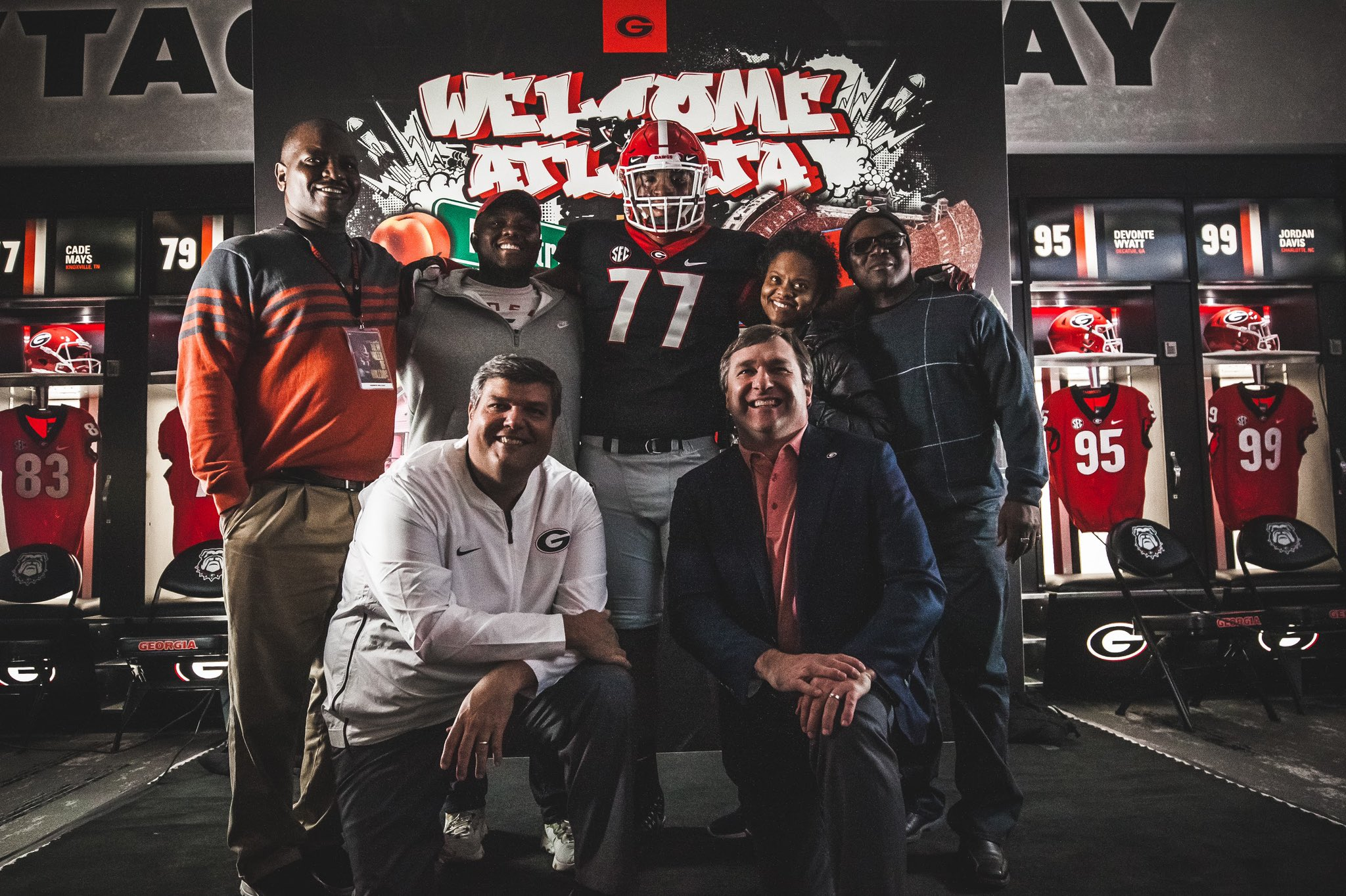 Georgia o-line coach Matt Luke and head coach Kirby Smart with Devin Willock and his family during a visit to UGA over the weekend. Photo: Devin Willock, Twitter.
