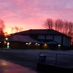 Image for the Tweet beginning: Beautiful sunrise over HHHS this