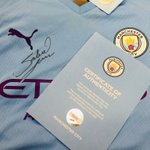 Image for the Tweet beginning: This Manchester City shirt signed