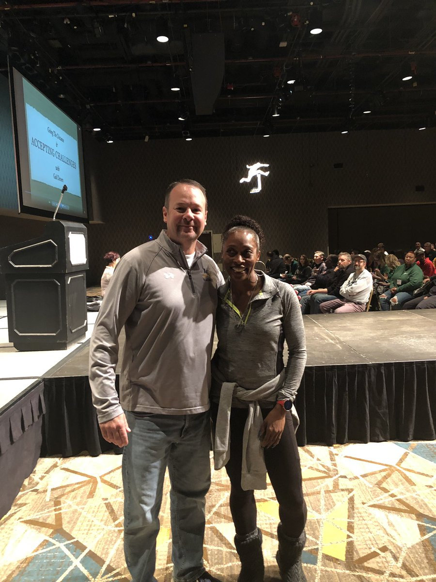 Coach Carr and Gail Devers. One of them is a 3 time Olympic Gold medalist.