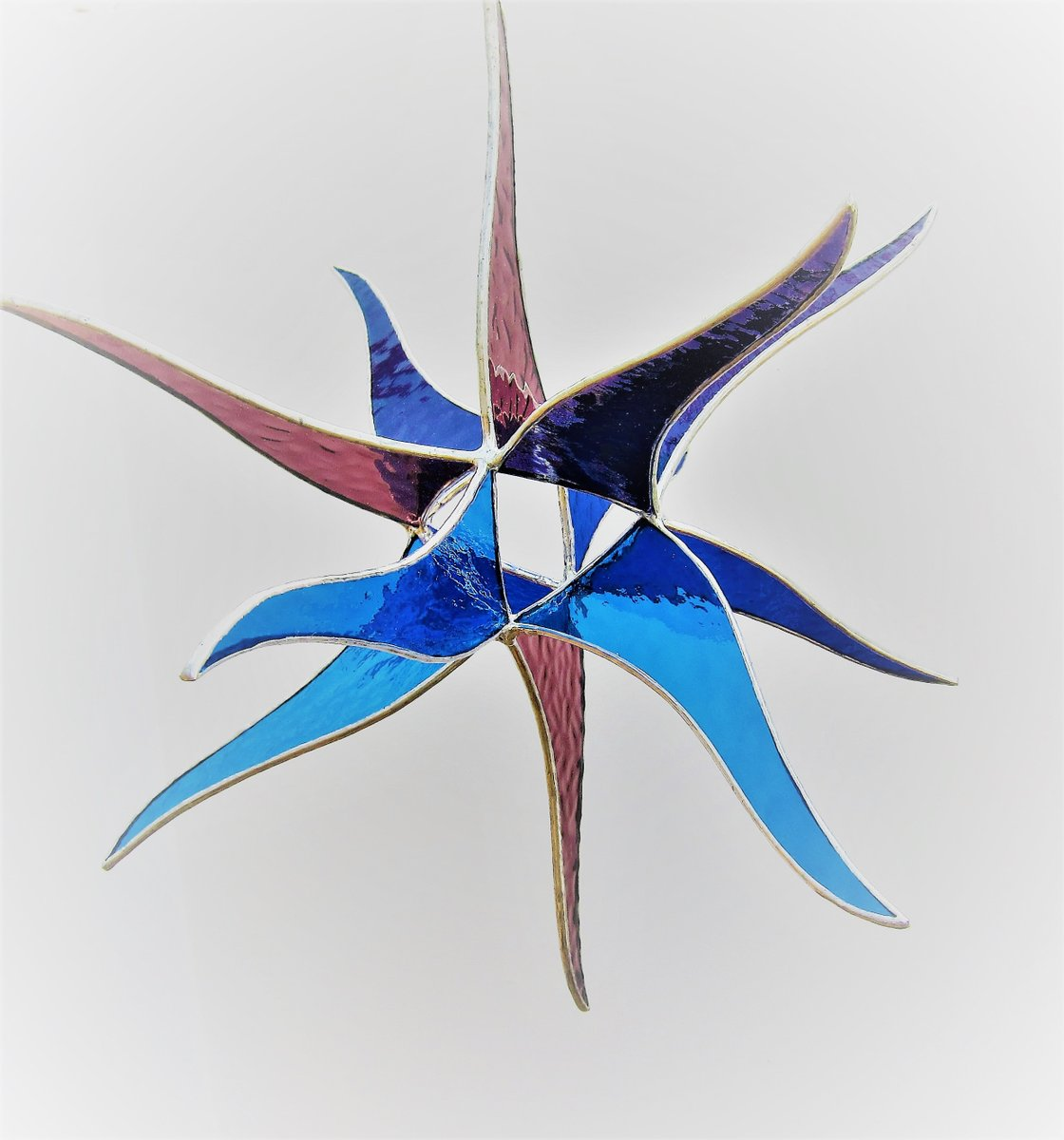 Just created for my #etsy shop: Stained Glass suncatcher, window hanging 3D Star sculpture in purple, grape,cobalt blue and light blue colors. 14 inches in diameter  #housewares #outdoor #gardendecor #blue #purple #3dglass