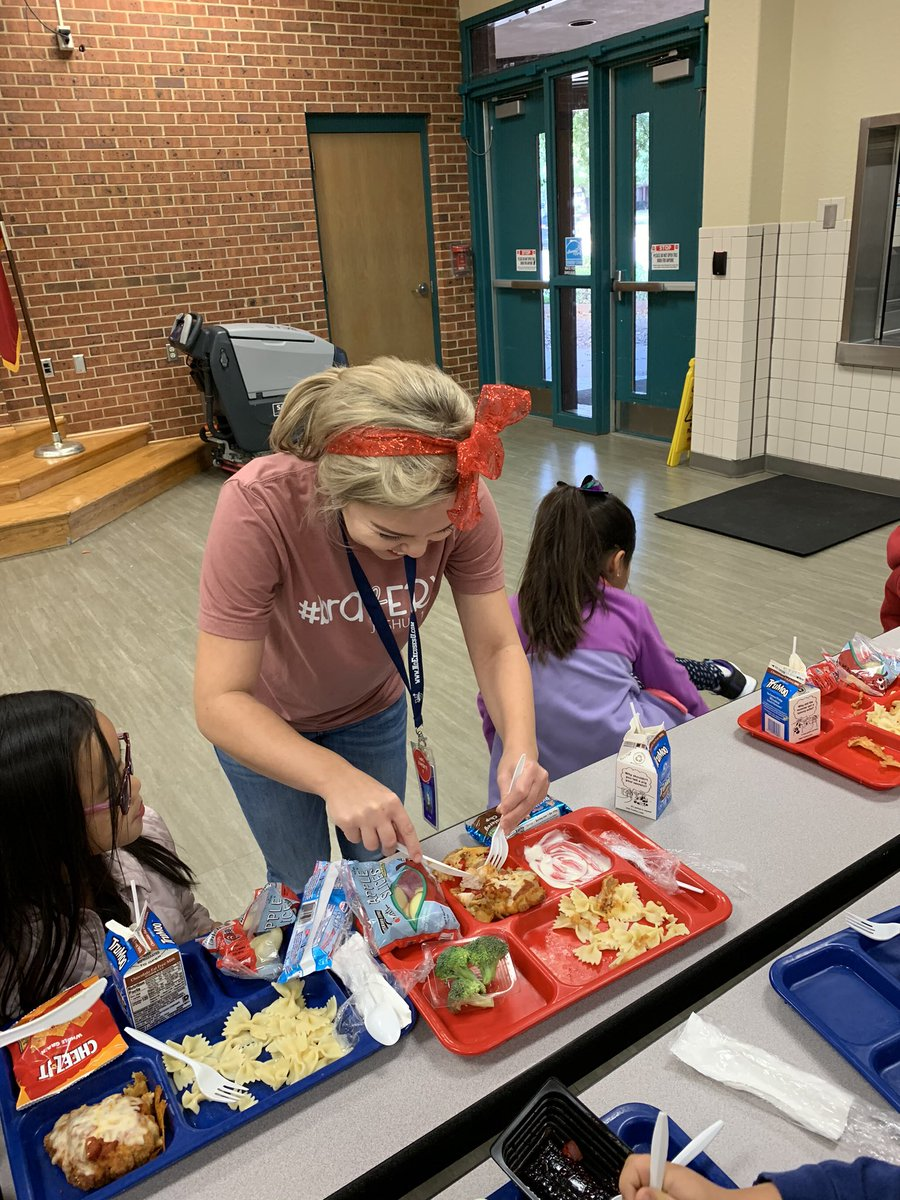 @Ms_Boteler is serving kindergarten students well by cutting their chicken parm for them with her awesome glitter bow! #wearegcisd @BearCreekElem #teambce #bcecalendar