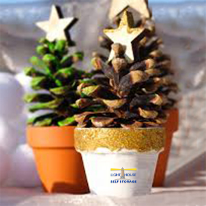 #DIY Holiday Project: Buy a pinecone in a pot and paint the pot with your favorite holiday color! Top it off with a star ornament so it looks like a mini tree. When the holidays are over, place this item in your storage unit and use it again next year!  #TipTuesday #crafts