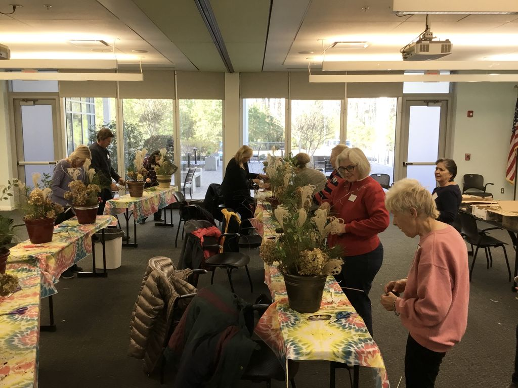 Our crafters had fun making beautiful outdoor planters with Pam at Pam's Craft Club! Check out our winter brochure for more crafting classes like this and more! #craft #crafting #DIY #winter #decor #decorating