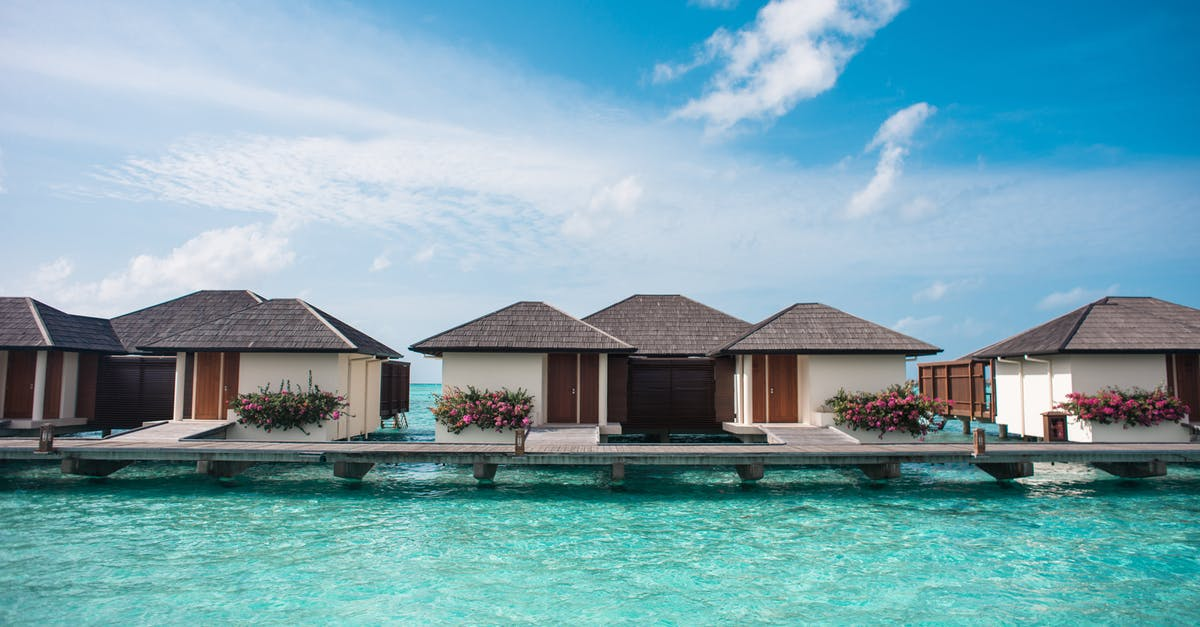 Cottage Houses on The Beach - Photo by Asad Photo Maldives () @pexels #Atoll #photo #photography #beautiful #travelphotography #travelphoto #pic