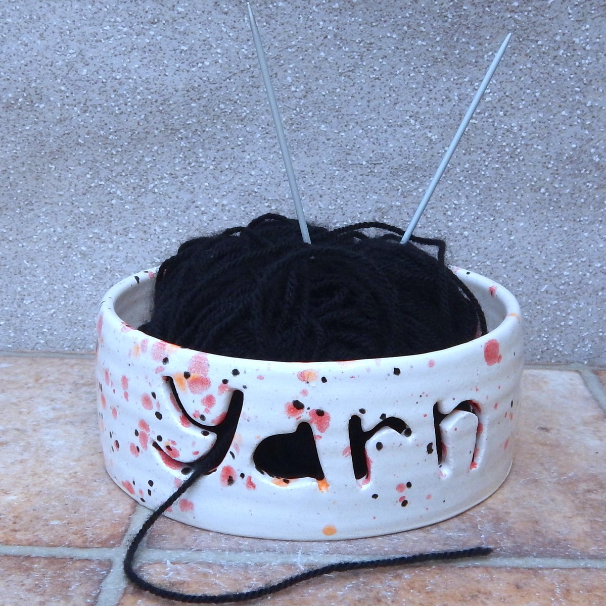 This yarn bowl would make a perfect gift for the knitter in your life.  With the word YARN cut out it stops the #wool skidding around under the furniture and picking up fluff.  #pottery #knitting #yarn #knitter #crochet #handmade #craft