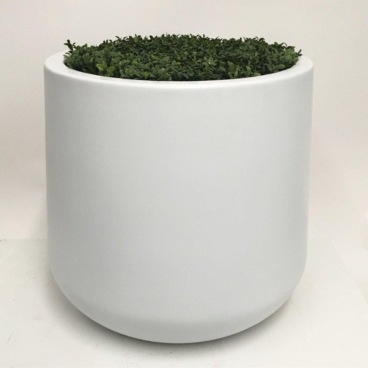 The #solo #planter brings a #soft #round #modern #organic presence to any #design scheme shown here in #matte #white • #hospitality #rooftop #garden #fiberglass #handmade #luxury #hoteldesign #hospitalitydesign