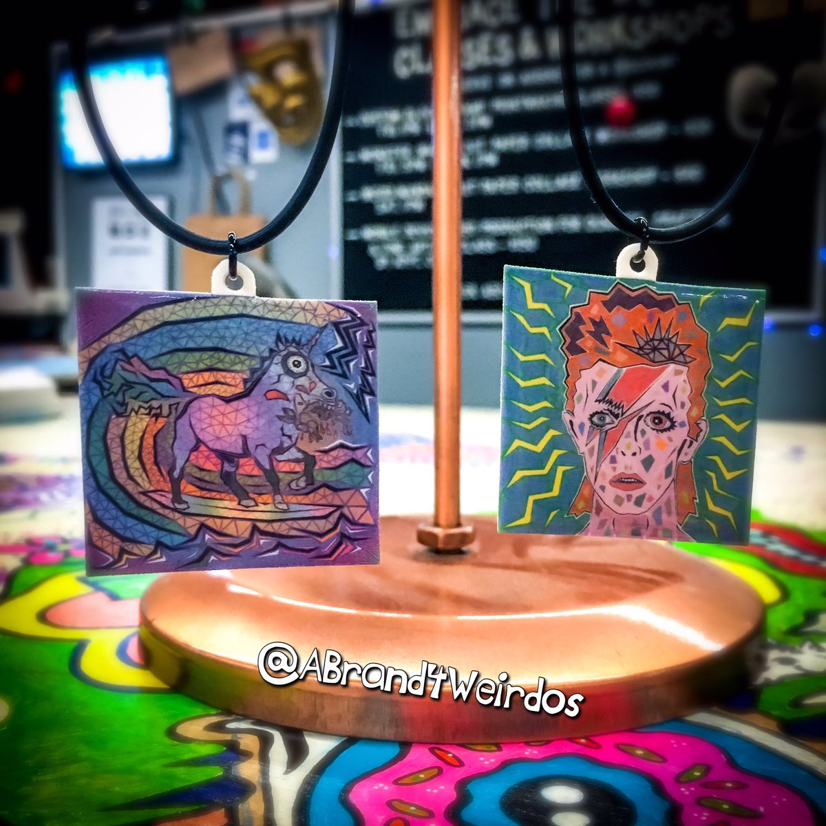 """Both original artwork #pendants by @brianabernhard, """"Feast of the Surfing Unicorn"""" & """"A Lad Insane"""" are brand new, #handmade and available only in our #SanPedro boutique inside @craftedportla this weekend!    #necklaces #unusualart #art #southbay #sanpedro #longbeach #giftideas"""