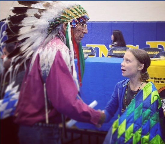 "Sioux Spiritual Leader Arvol Looking Horse  bestowed a Lakota name upon Greta Thunberg:  ""Maphiyata Echiyatan Hin Win,""  which means  ""Woman Who Came from the Heavens."" Former tribal chairman Jesse Taken Alive told Thunberg: ""You have Awakened the World. We Stand with You."" <br>http://pic.twitter.com/INE7MKie3l"