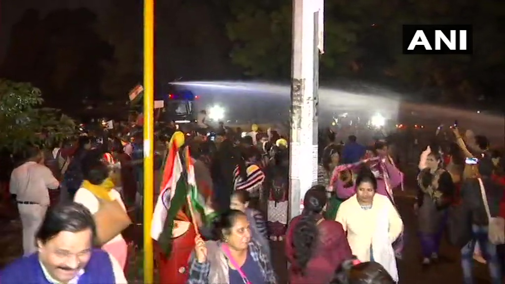 Delhi: Police use water canons on protesters who were holding a candle march from Raj Ghat to India Gate. Protestors are demanding justice for the Unnao rape victim who died yesterday.