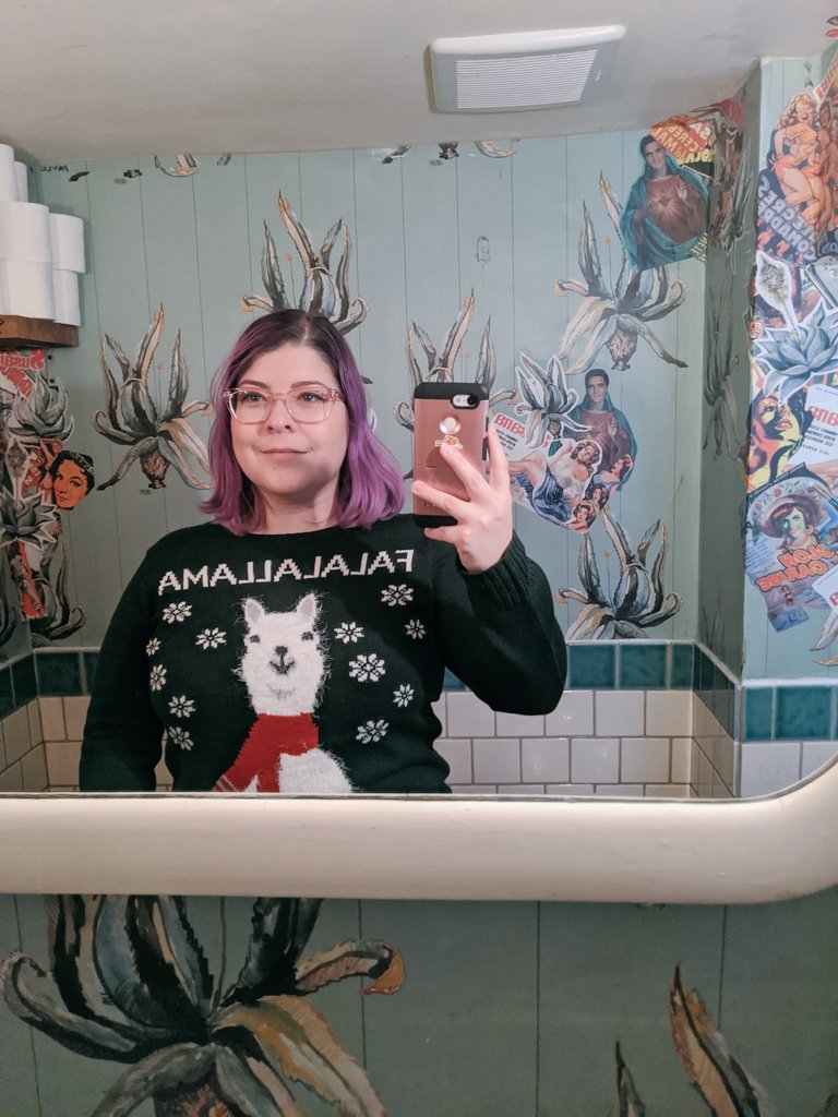 We're wearing our holiday sweaters today just cuz.
