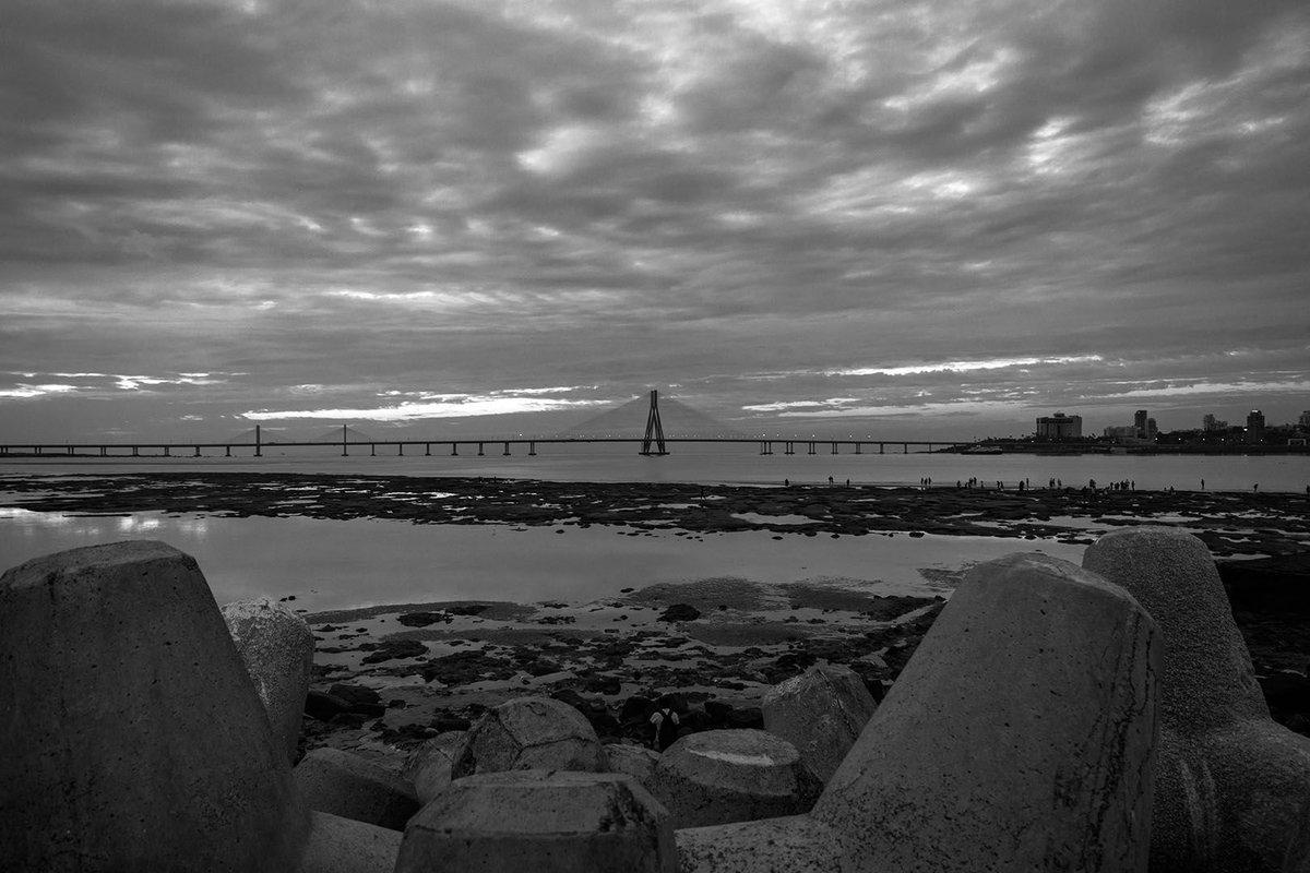 Which photo do you like more? Colour or Black & White?#sealink #photography #monochrome #mumbai #photographer #nikonphotography  #blackandwhitephotography #ilovephotography #photographerlife #picoftheday #blackandwhite #bandraworlisealink @nikonindia @lonelyplanet #india #nikon