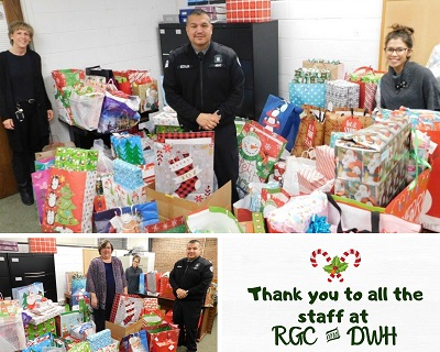 photo collage of two photos of three people standing amidst hundreds of wrapped christmas presents. a note on the side says thank you to the staff of RGC and DWH.