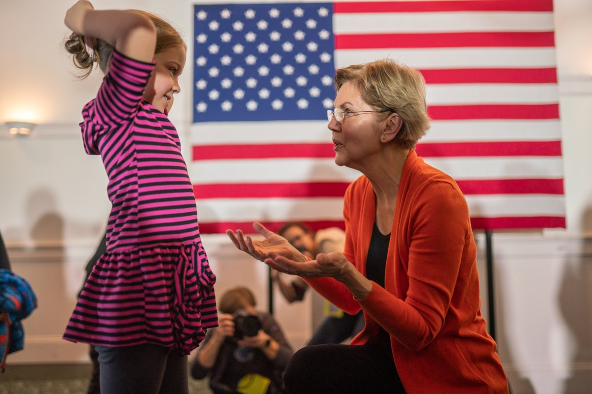Elizabeth Warren greets a young girl at the Rochester town hall.