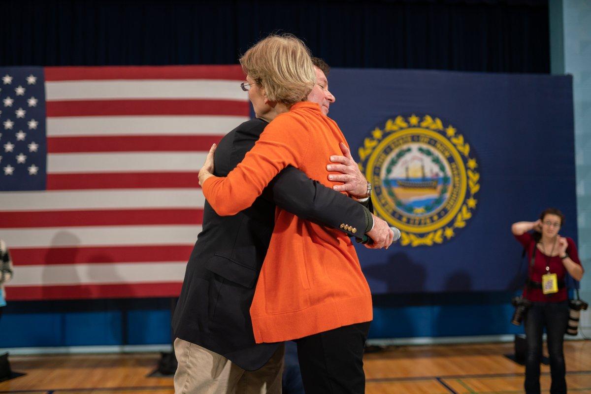 Elizabeth Warren hugs an attendee at the Rye town hall.