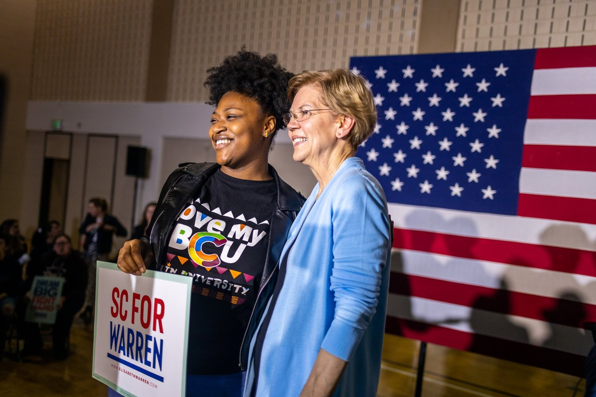 Elizabeth Warren takes a photo with a supporter at the Charleston town hall.