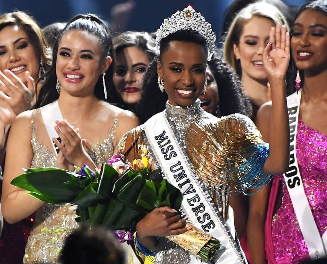 Congratulations to Miss Universe 2019 -  Zozibini Tunzi from #southafrica My sisters, Black is beautiful. No need to bleach. Nothing against wigs, but we never see some people's hair at all! Your hair is beautiful my sisters. <br>http://pic.twitter.com/ZKDi30QwLw