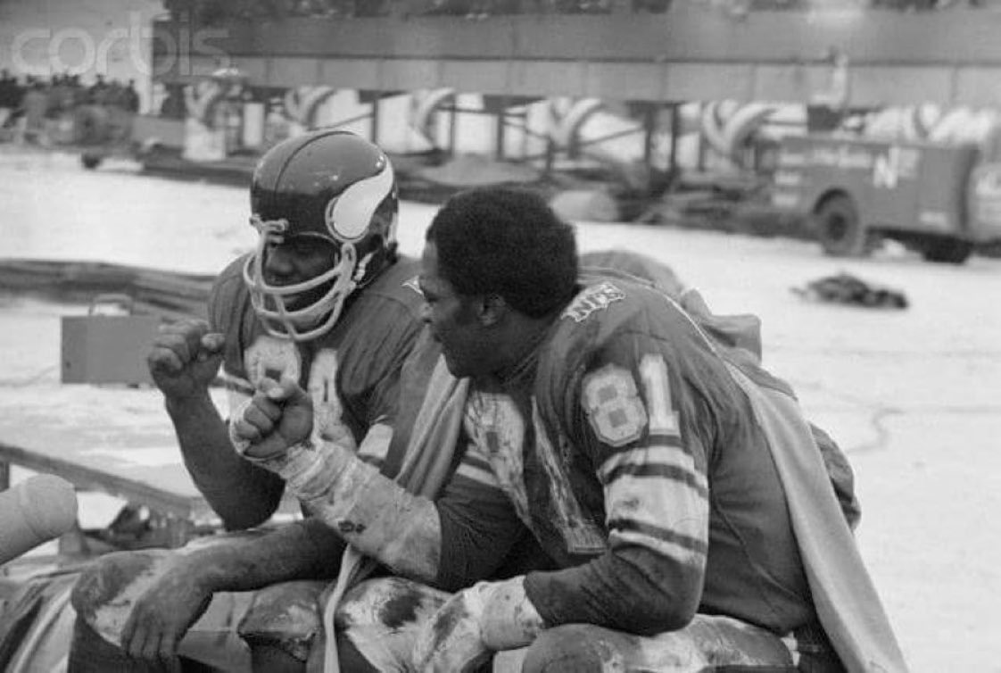 Alan Page and Carl Eller share a fist bump after yet another productive Sunday of kicking ass upon the frozen earth.