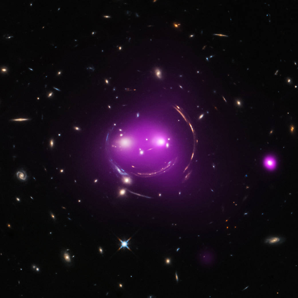 The shirt we made for Curiosity Box XIV celebrates the Cheshire Cat: a galaxy group 4.6 billion light-years away whose light is gravitationally bent into the appearance of a grinning face by massive stuff (dark matter!) in between it and Earth. curiositybox.com