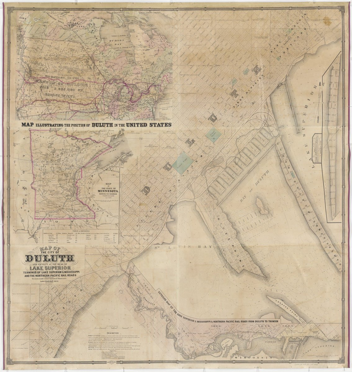 a city in the middle of a page with the bay to the lower right and in the upper left insets showing Duluth in Minnesota and Minnesota along the US railway system