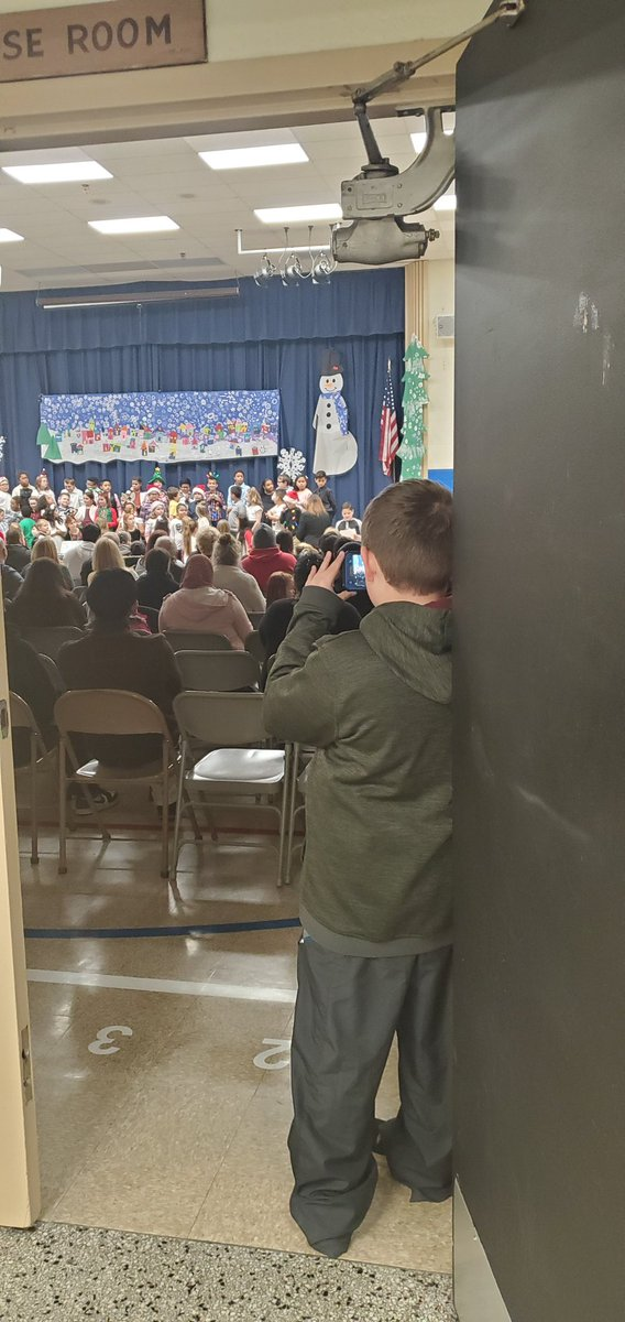 A proud brother capturing his sister's performance in our winter concert! #Family @NorwoodES @canstafford @MusicAtNorwood