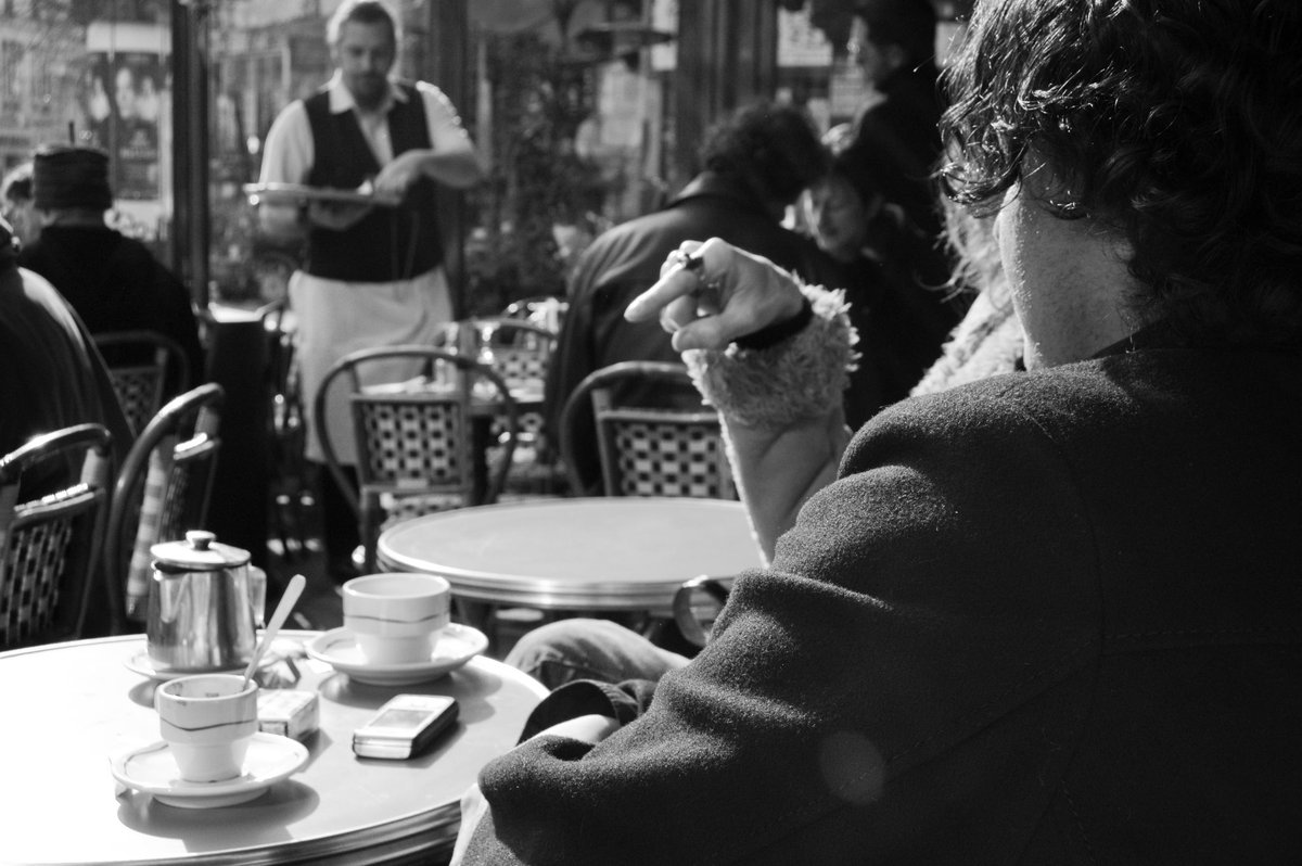 Paris  They find a table in an outdoor cafe, and instead of finding Paris, let Paris find them. Share a Beaujolais and let time stand still.   He'd watch her artistic eye drinking the city in, all the while searing every moment of this night into his mind.  Forever <br>http://pic.twitter.com/b79RSZ9MF9