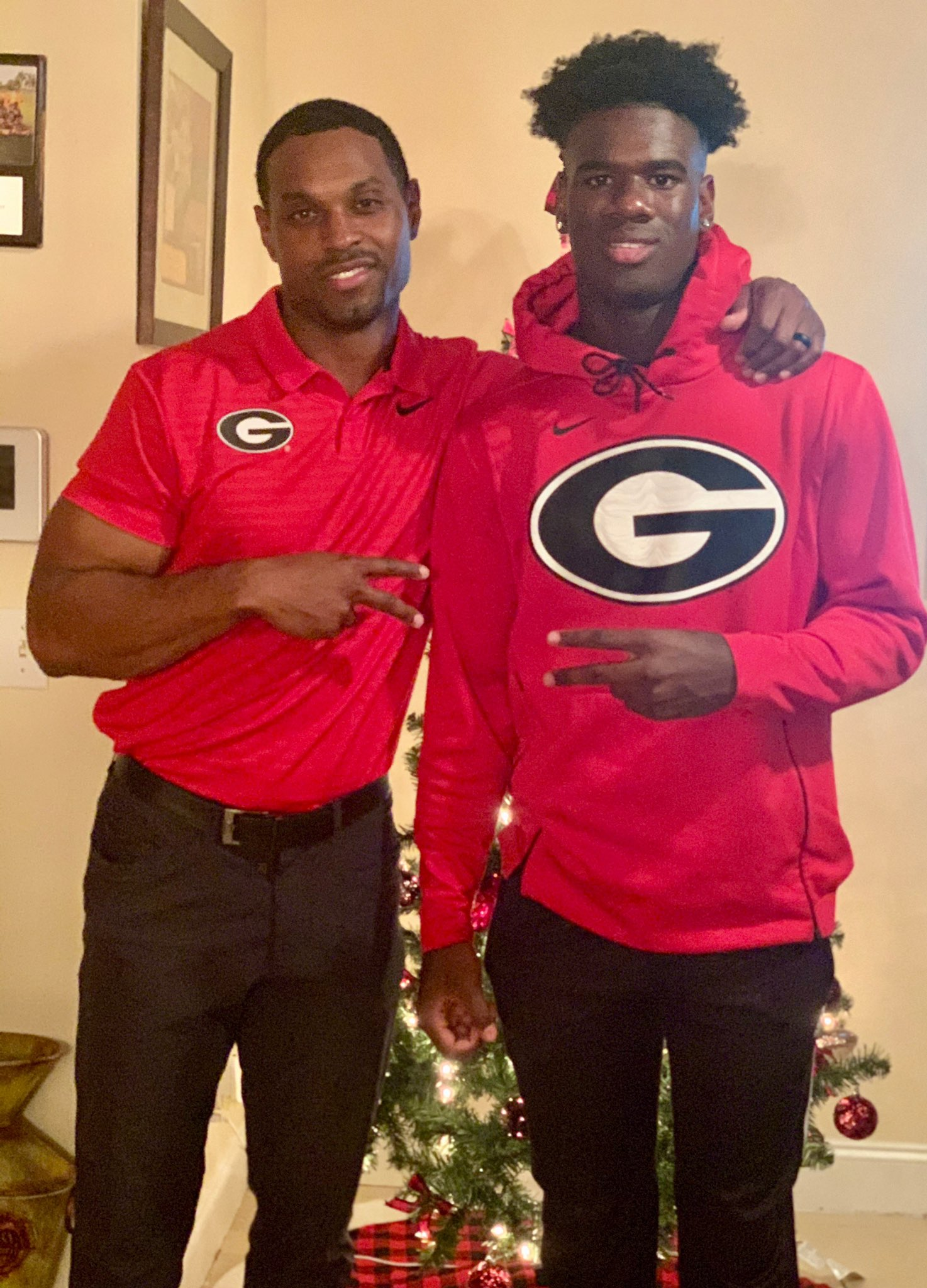 Rosemy and UGA wide receivers coach Cortex Hankton(Photo from Marcus Rosemy's Twitter)