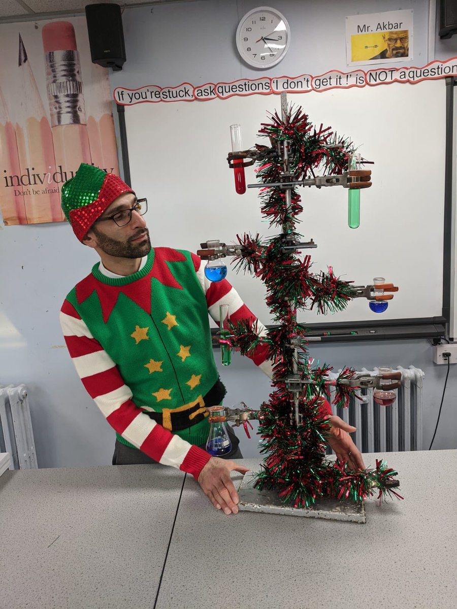 Why I love being a teacher:  You get to dress like an elf and make a chemist-tree  for    #XmasJumperDay . <br>http://pic.twitter.com/QCtgRzMcqu