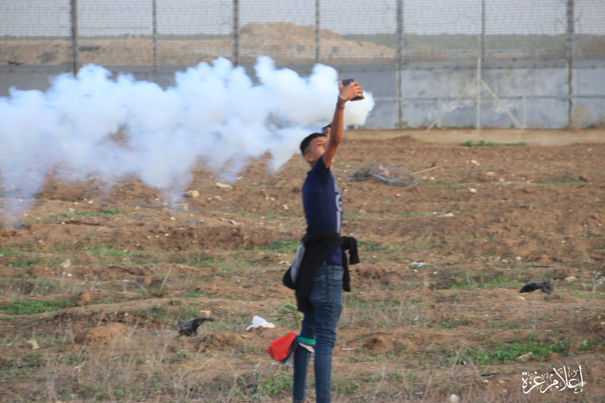 A child in Gaza takes a selfie with gas-bomb fired by israeli forces. <br>http://pic.twitter.com/z38ubI40Sn