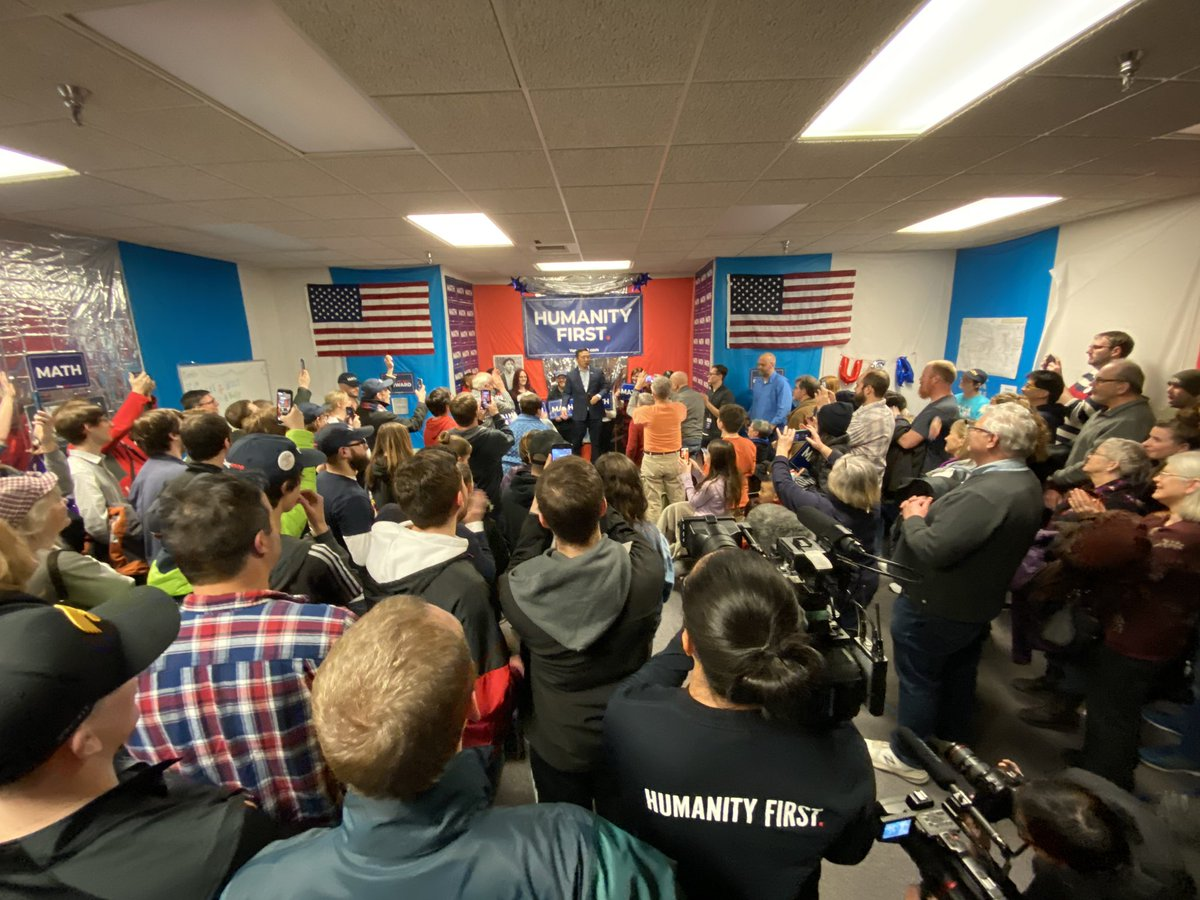 """Andrew Yang, speaking at his Dubuque office opening, asks for a show of hands. """"How many of you are here because you saw a TV ad?"""" (No hands go up.) """"That's interesting. We spent a lot of money on those ads."""""""