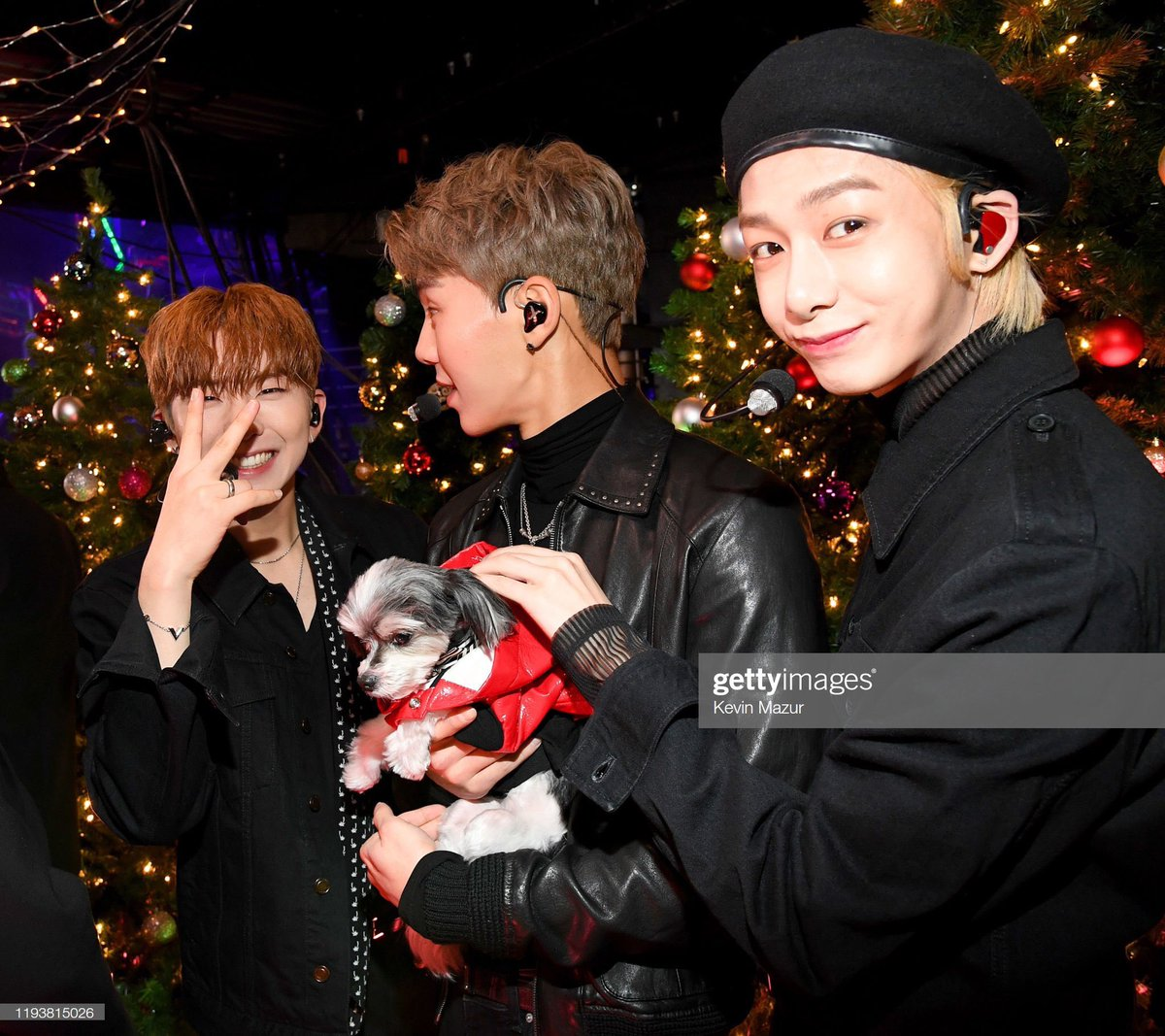 hyungwon smiling menacingly at the camera before he steals the dog <br>http://pic.twitter.com/8SJXwszB9Q