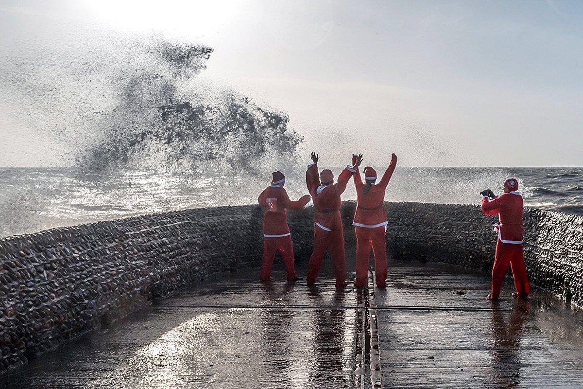 Brighton #britishweather #santa #christmas #streetphotography #storms #beachlife #splash #wetthrough #bhafc #weatherpics #party
