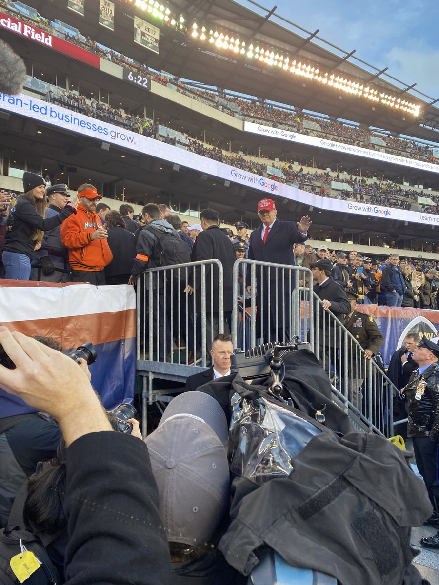 PHOTOS: Trump Takes Turns Sitting With Army, Navy Cadets At Army-Navy Game