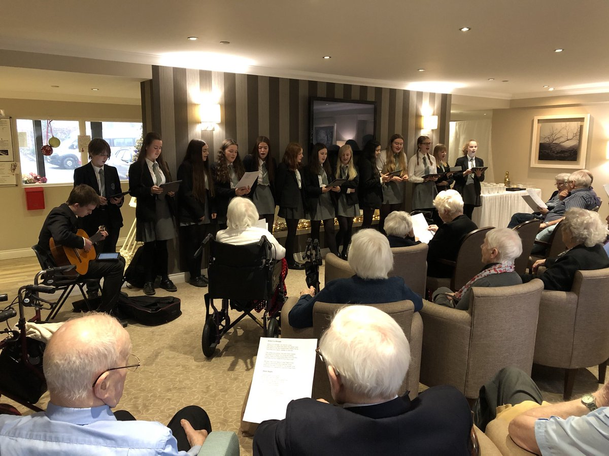 @Ilkleygrammar Year 10 pupils spreading some Christmas cheer this afternoon with carol singing to a very big crowd from Emmandjay Court, @yourMHA #community #christmas #carols